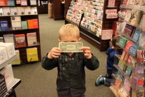 He found a dollar bill on one of the bookshelves!